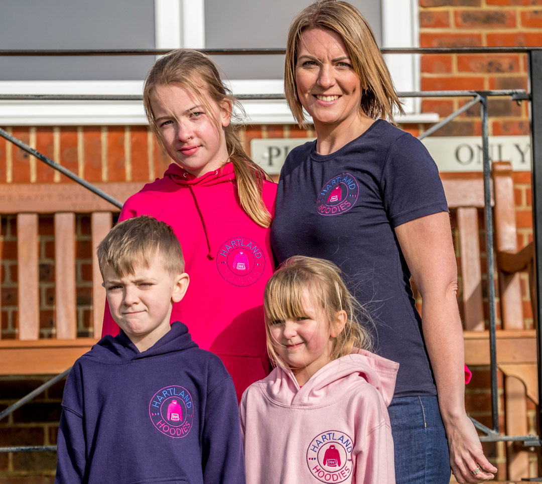 photo of director Sophie english with her three children wearing Hartland Hoodies