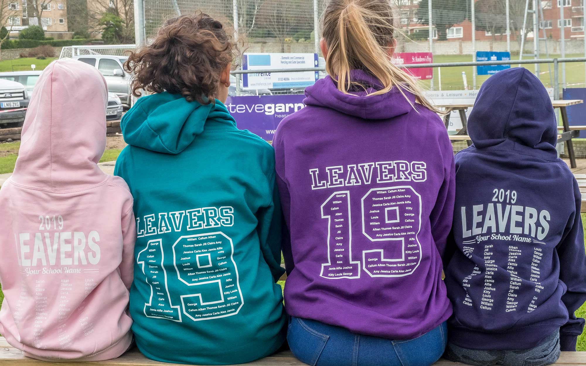 photo of four children wearing leavers hoodies