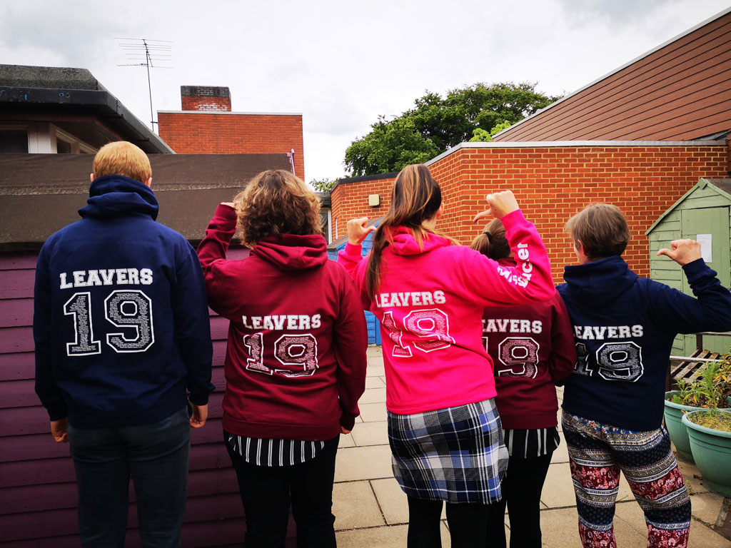 photo of Camestone teachers wearing their 2019 leavers hoodies