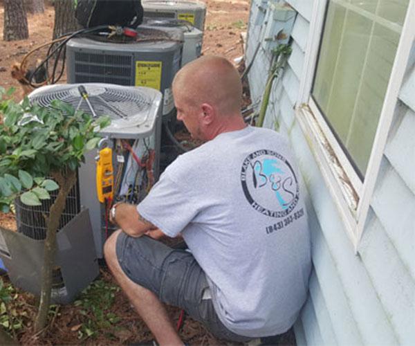 blake & sons repairing an ac unit