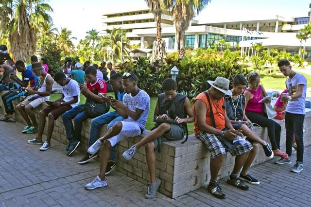 group of people sitting outside in Cuba