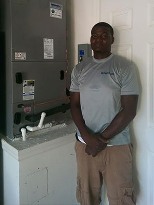 Kelvin next to HVAC unit