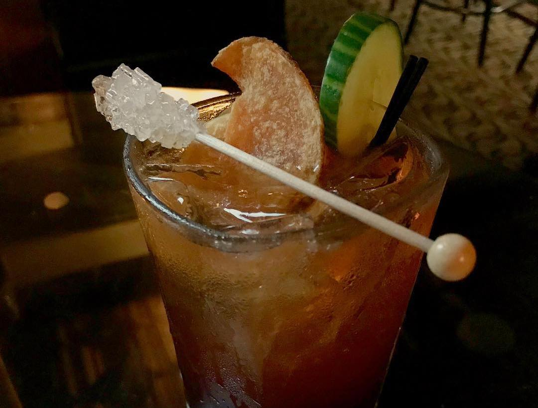 sugar stirrer topped drink at Speakeasy