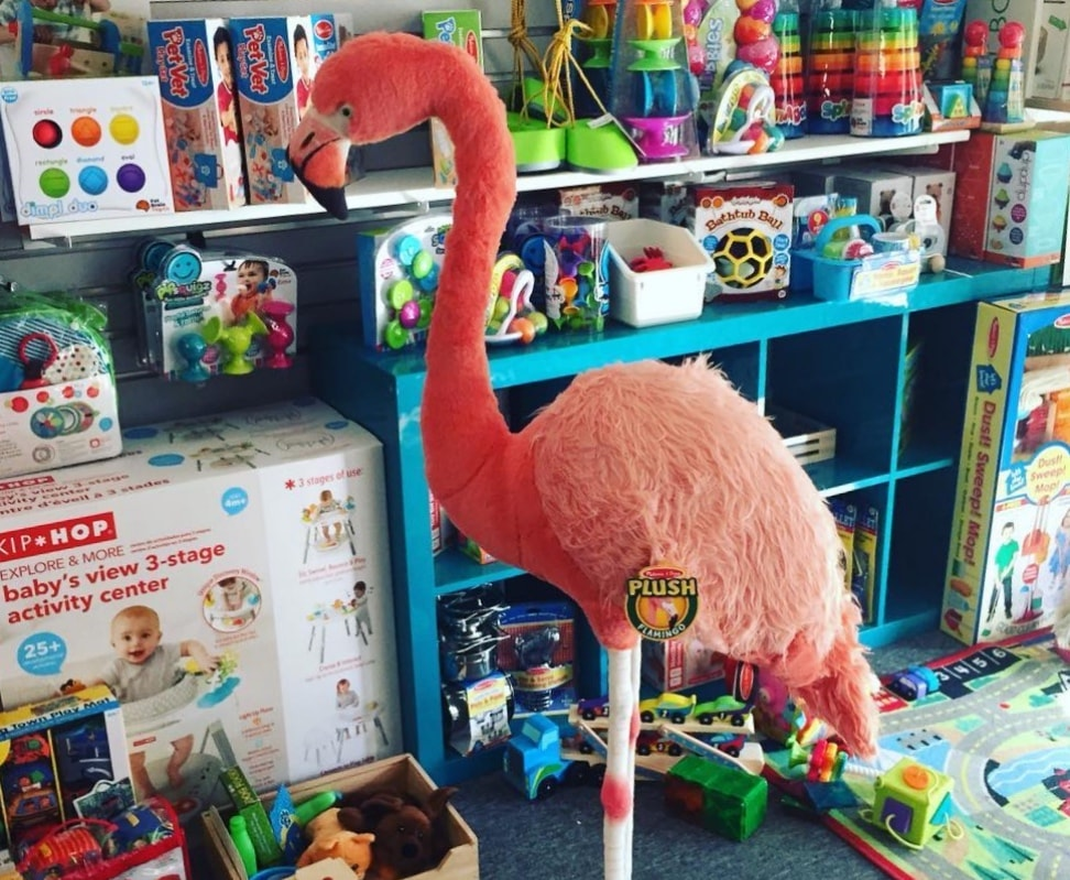 toy display, including a large toy flamingo, at Happy Baby Company