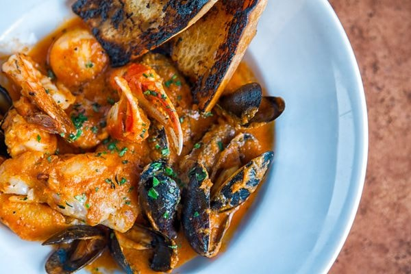 a seafood dish at Cioppino Restaurant & Cigar Bar