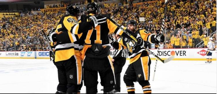 Pittsburgh Penguins celebrate after scoring
