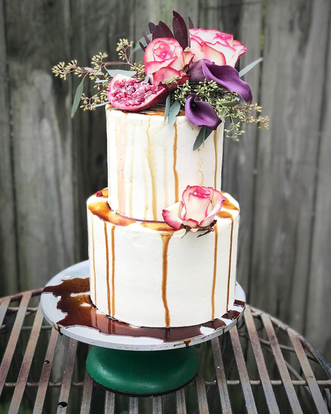 Two tiered cakes topped with real flowers
