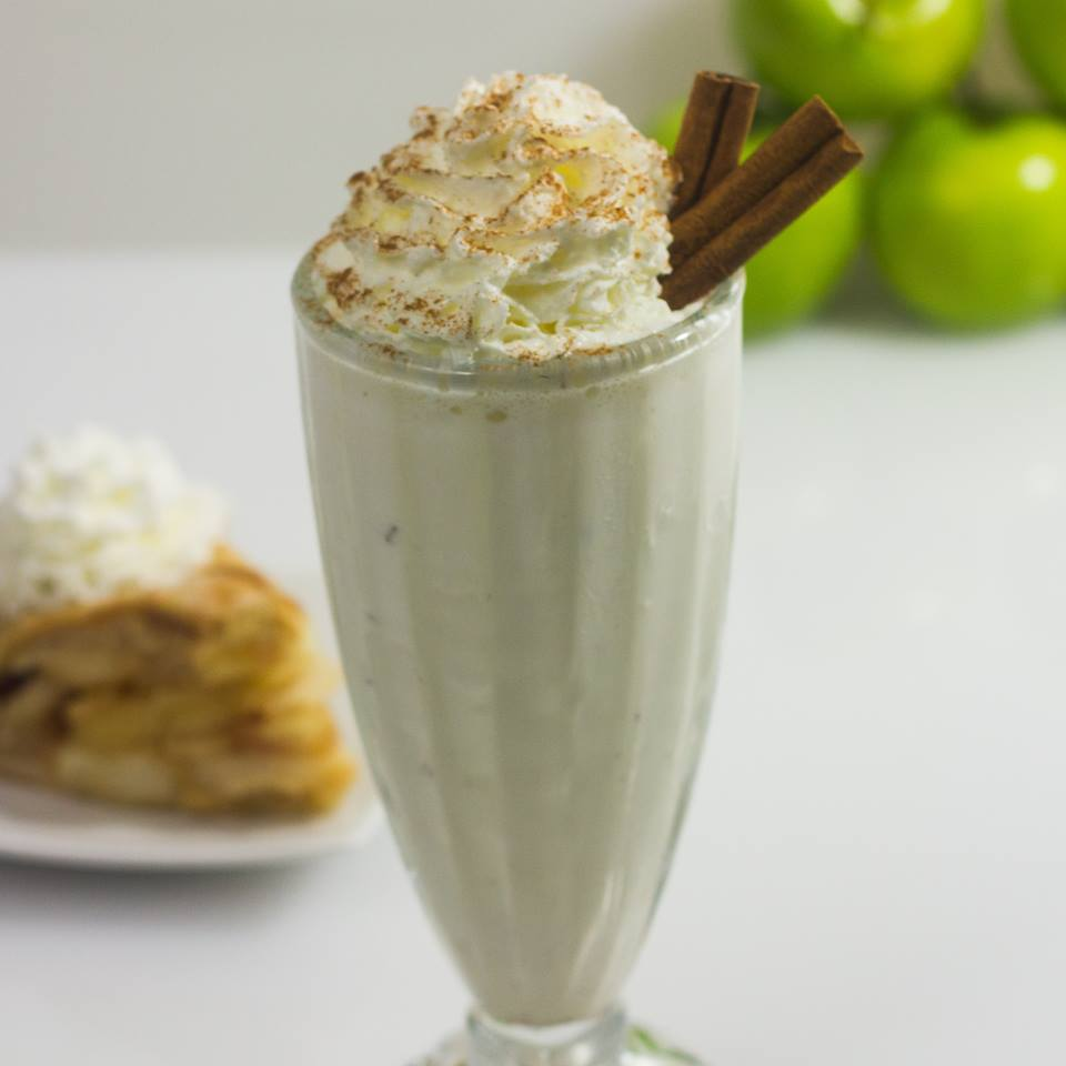 Apply Pie milkshake garnished with cinnamon sticks