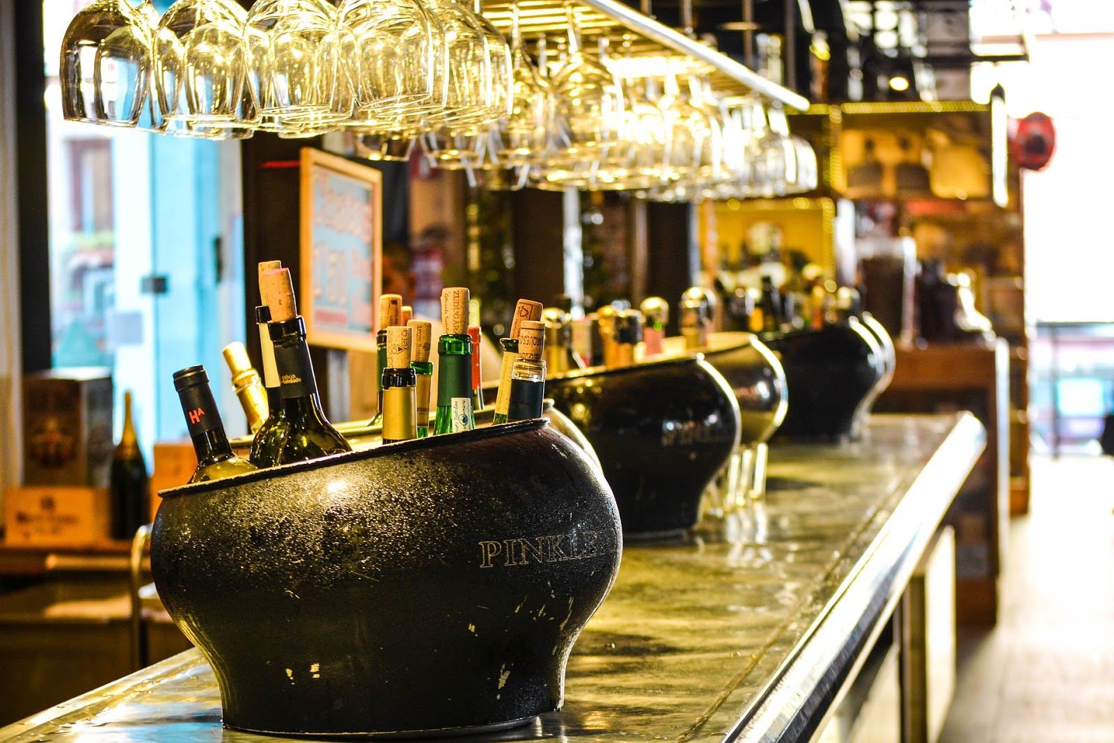 This bar is ready for St. Patrick's Day with couldrons of beers ready to grab on their bar.