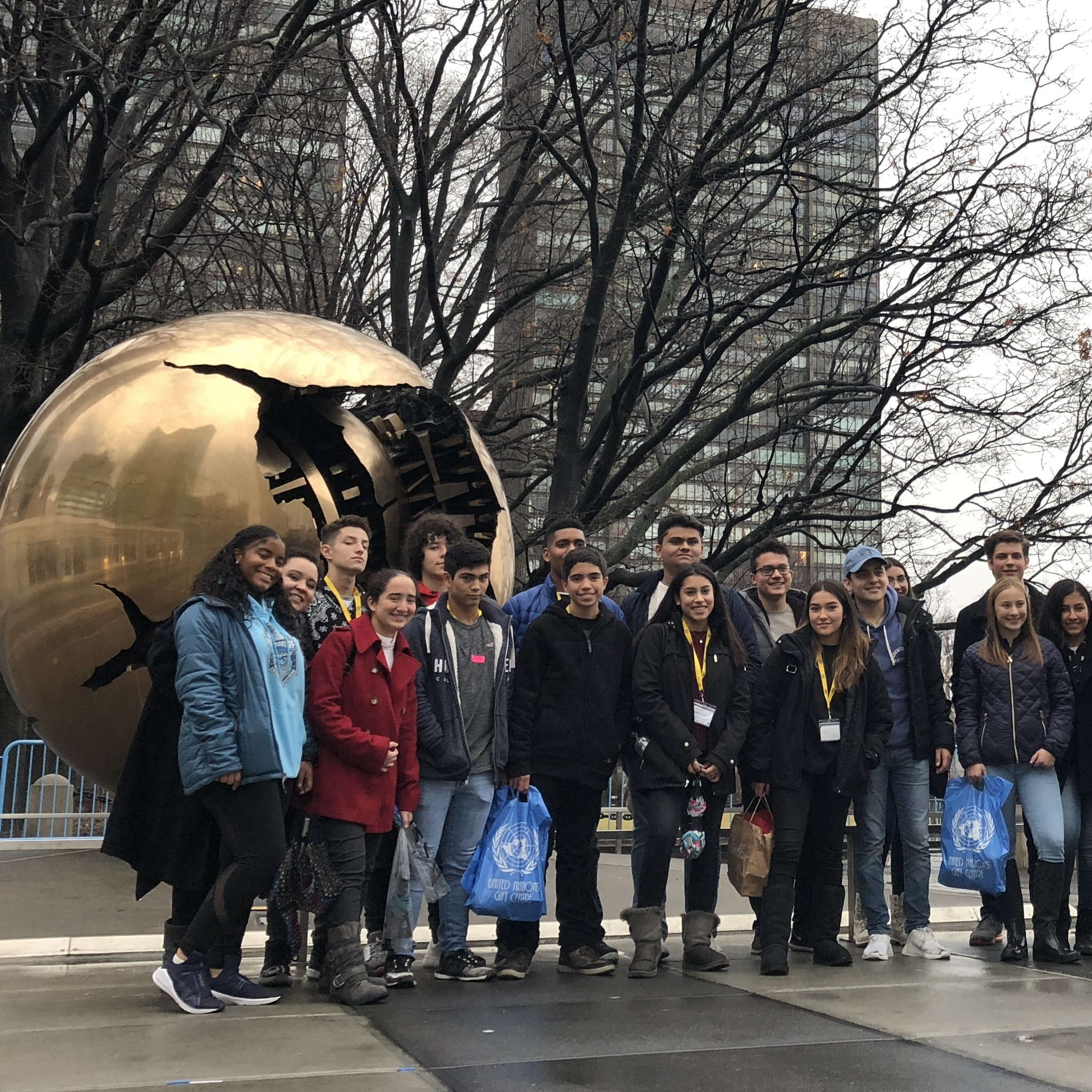 business students posing at the united nations during their educational trip to new york