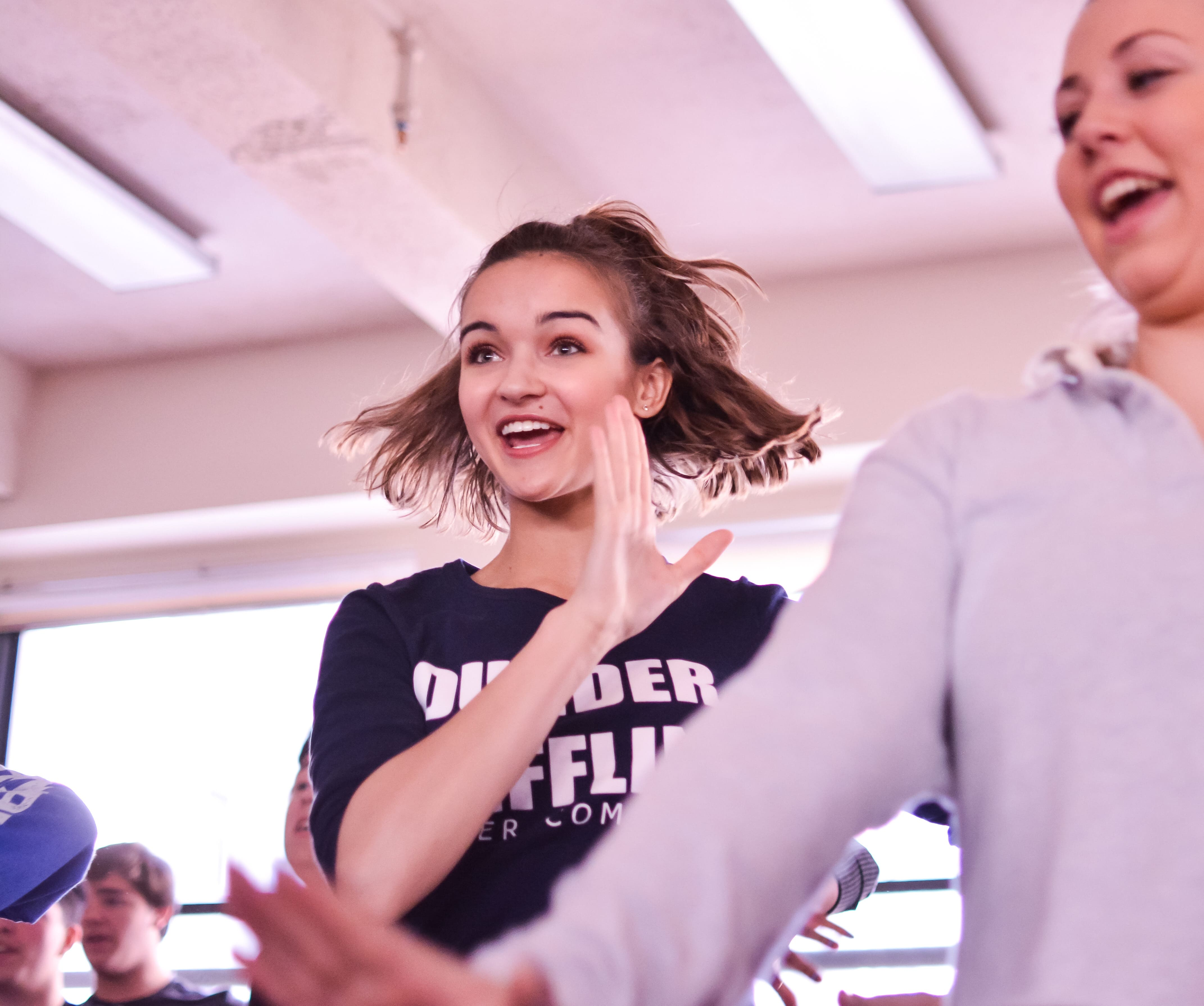 Choir student dancing at a workshop during a trip to new york city