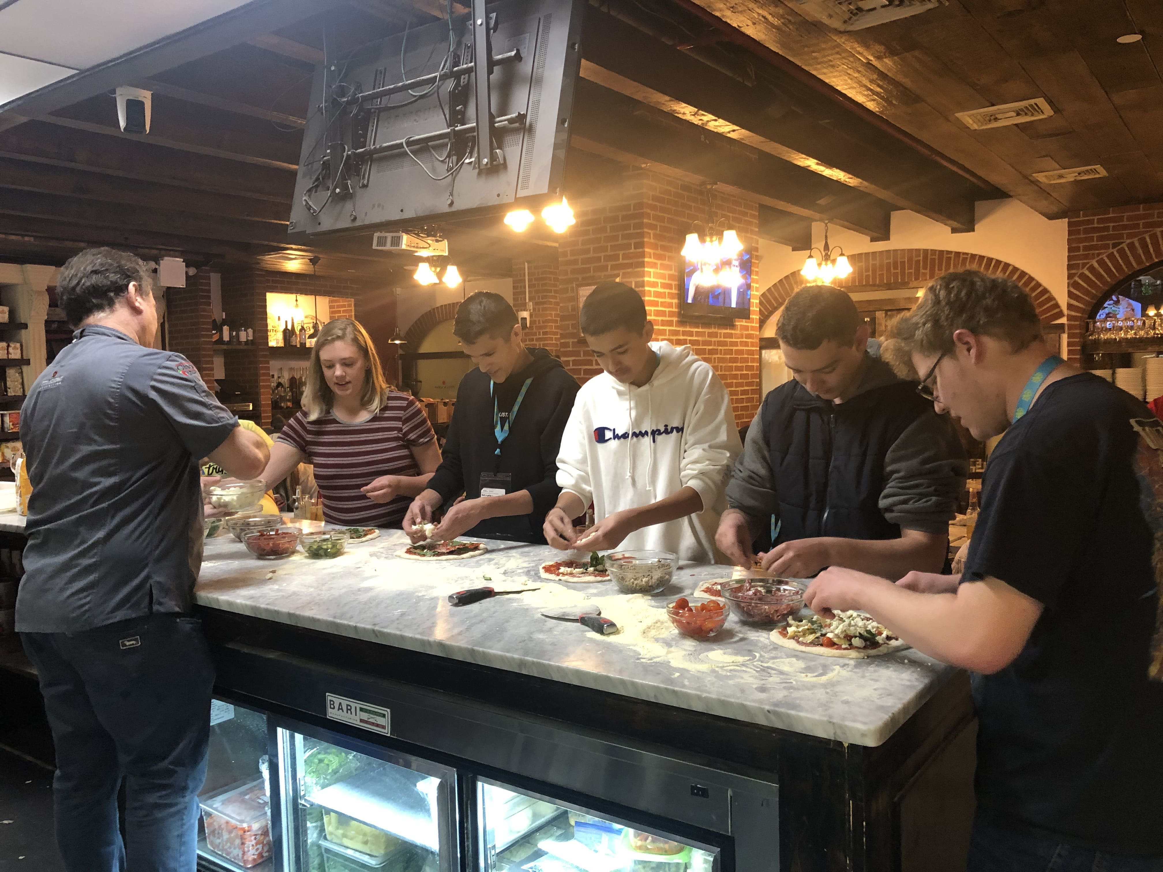 culinary students making pizza on a trip to new york city