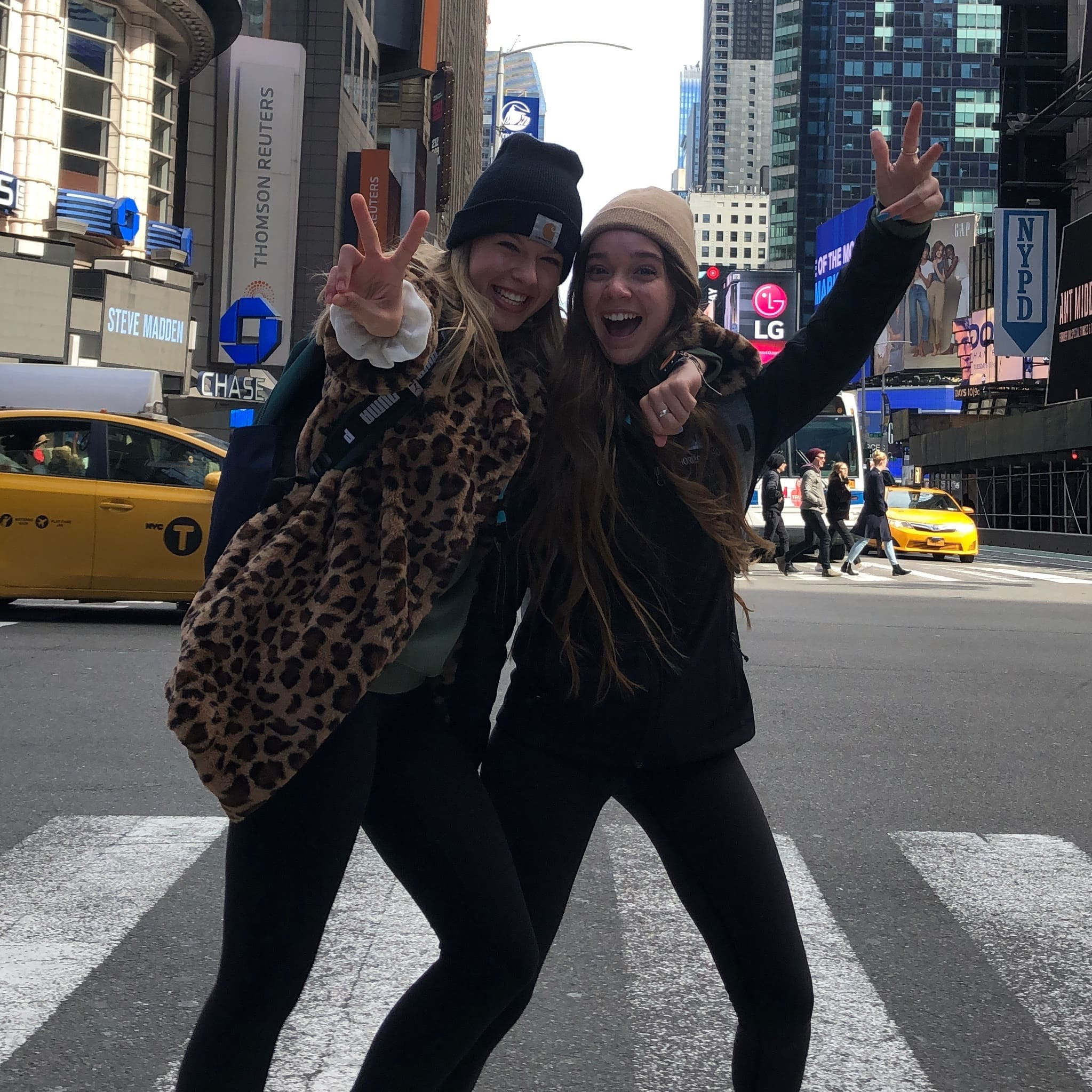 choir students striking a fun pose in a NYC crosswalk during their student trip