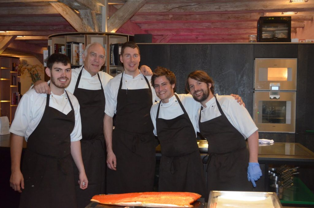 Chef Plotkin and four other chefs pose for a photo in the Noma test kitchen.
