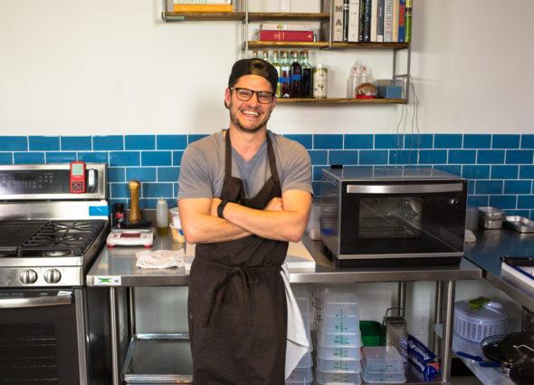 Chef Plotkin stands in the test kitchen.