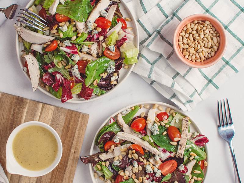 Healthy dinners for two: two bowls of fresh, green salad