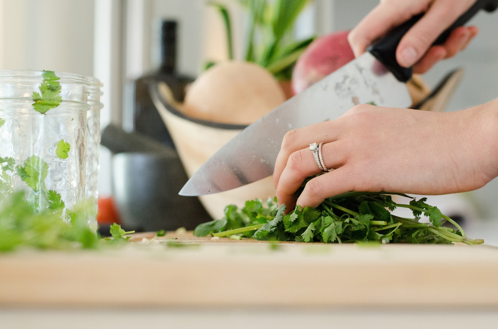 What to make for dinner: A woman chopping cilantro