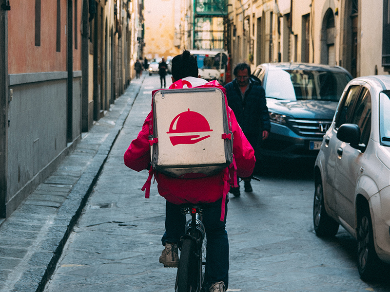 Best prepared meal delivery service: A man delivers takeout on his bike