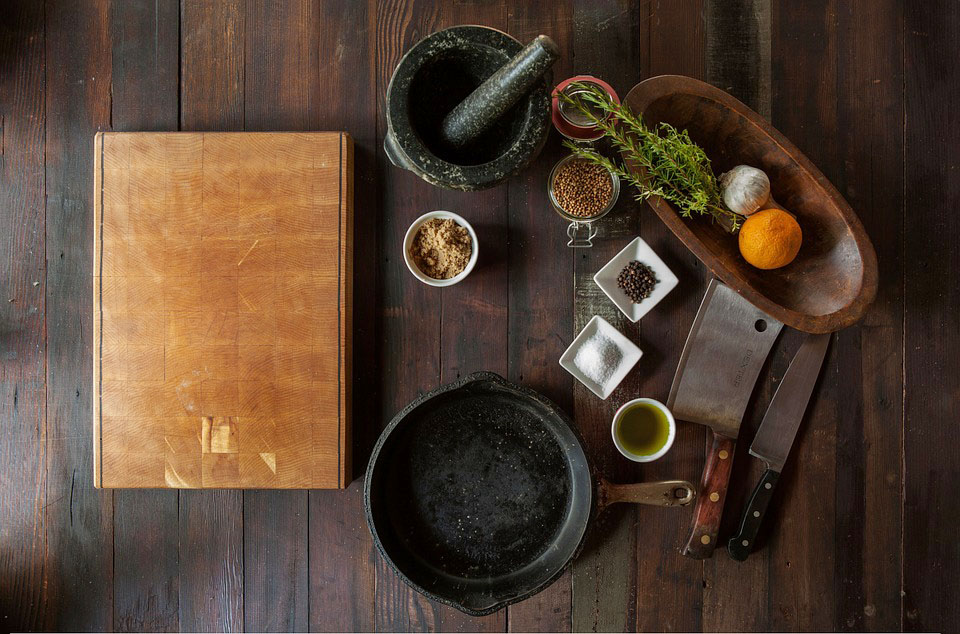Hello Fresh recipes: ingredients and cooking utensils on a wood countertop
