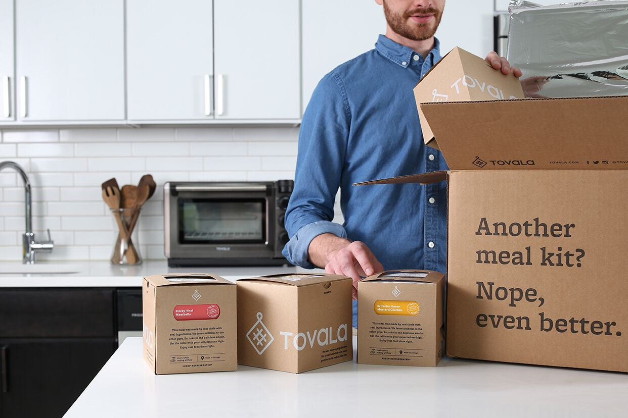 Prepared meals delivered: A man unpacks Tovala meal boxes