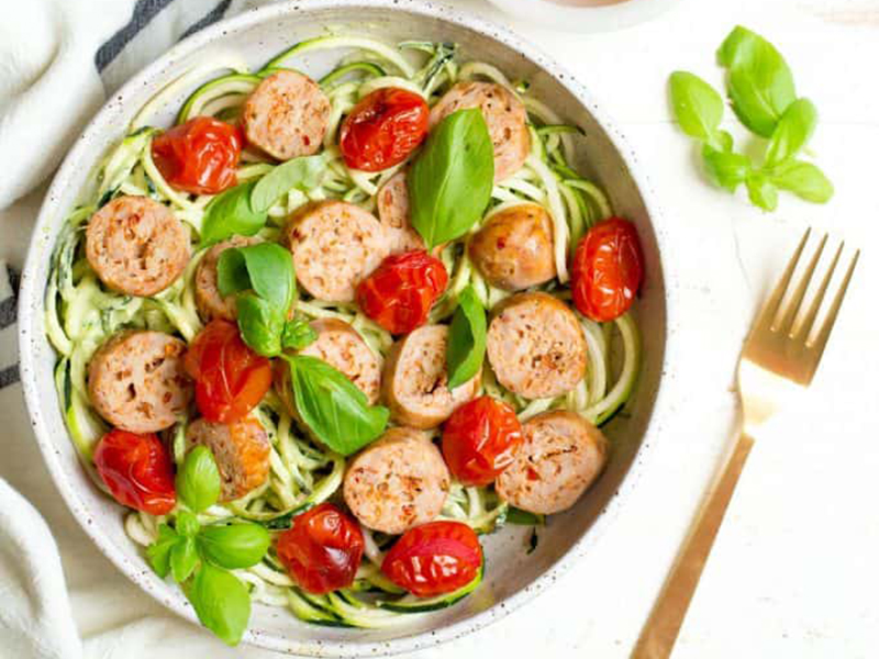 Low-carb meals: Sheet Pan Sausage, Pesto, and Roasted Tomato Noodle Bowl