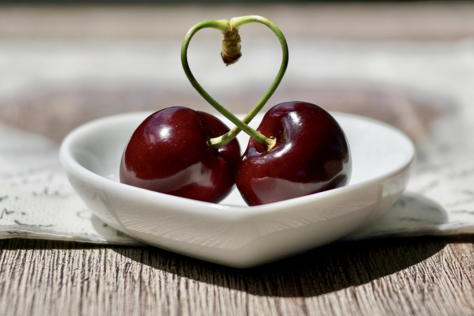 Heart-healthy meals: two cherries with their stems forming the shape of a heart