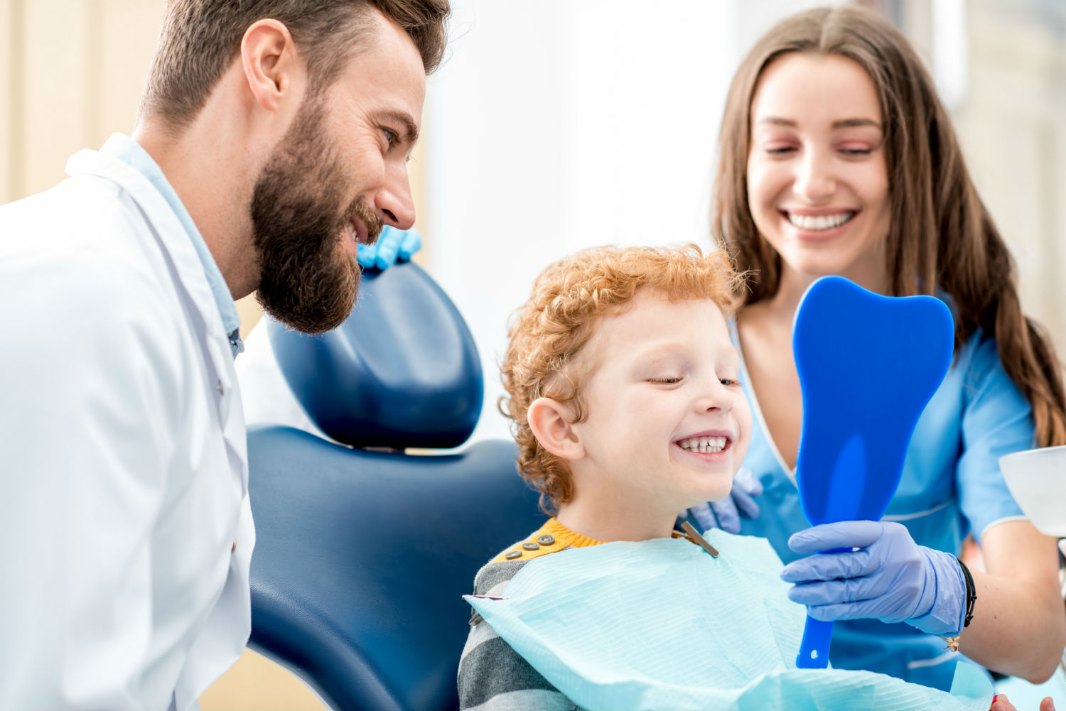 dentist showing little boy how to brush his teeth!