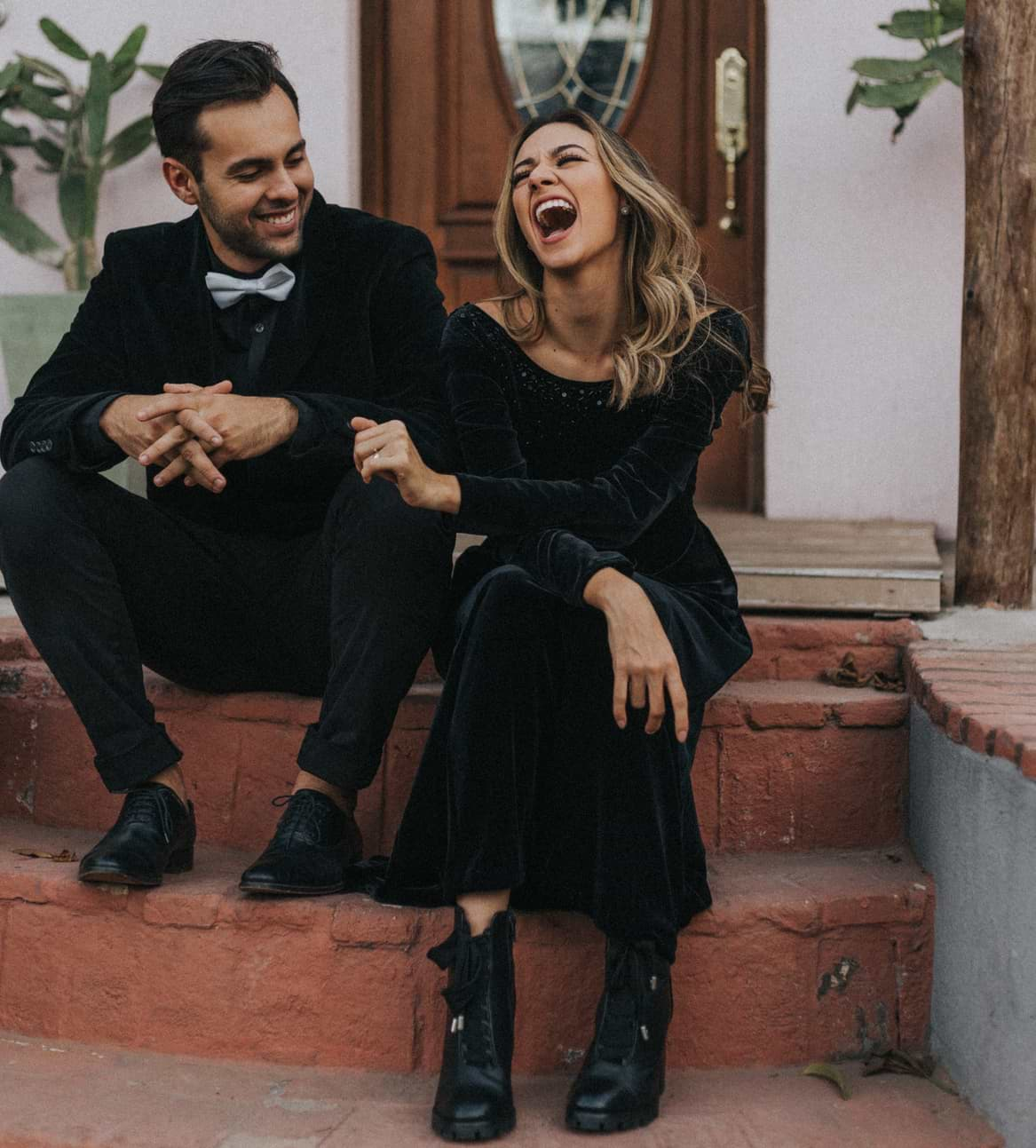 couple wearing black at a wedding party