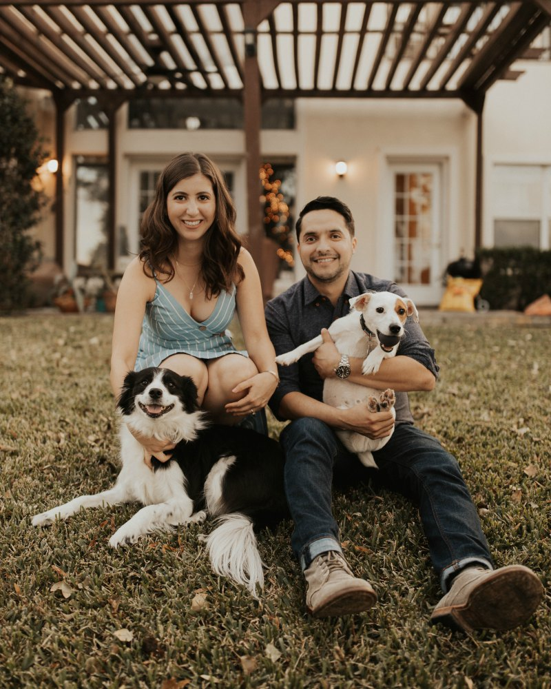 Dr. Muñoz with wife and dogs