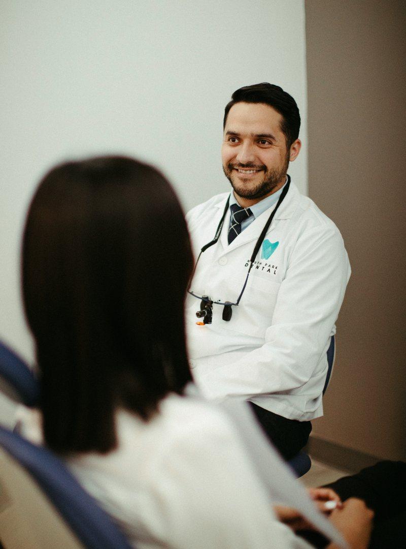 Dr. Muñoz smiling at patient