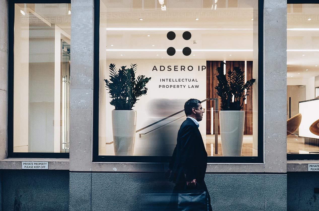 Man walking in front of Adsero IP Offices