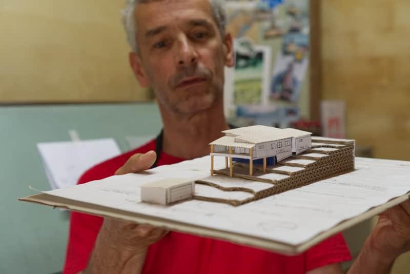 Marc Stahli holding hand made house design model