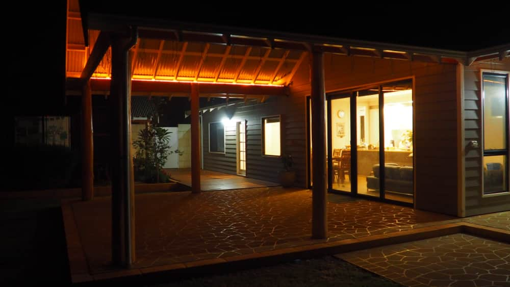 Evening photo of patio extension by sunset design