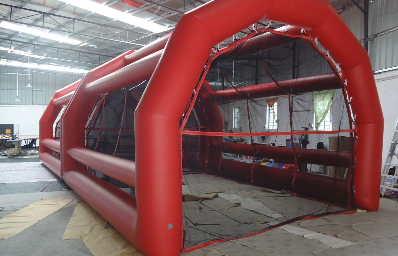 Batting Cage is fully enclosed and includes a pitching machine. 50' l x 16' w x 12' h.