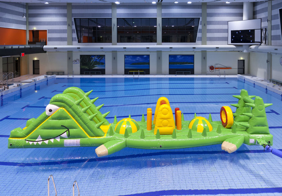 The Floating Crocodile Water Obstacle Course is 33' l x 10' w x 8' tall. Life Guard Required to be on duty and supplied by customer.