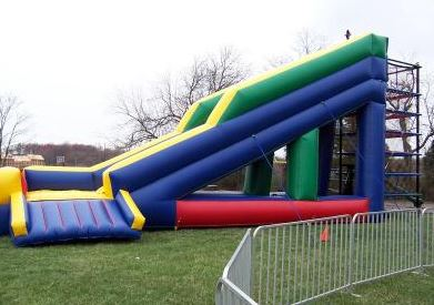 The Spider Zone consists of five interwoven, colorful rubber layers. Children (and adults) climb up through each layer before exiting the 24' tall slide. (35' l x 10' w x 24' h)