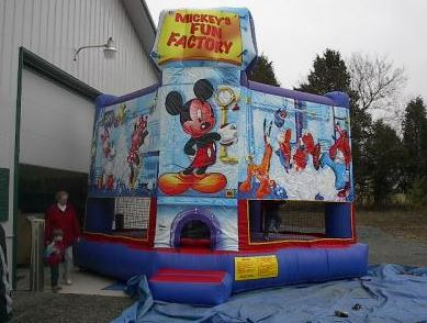 Disney theme moonbounce. (15' long x 15' wide x 16' tall)