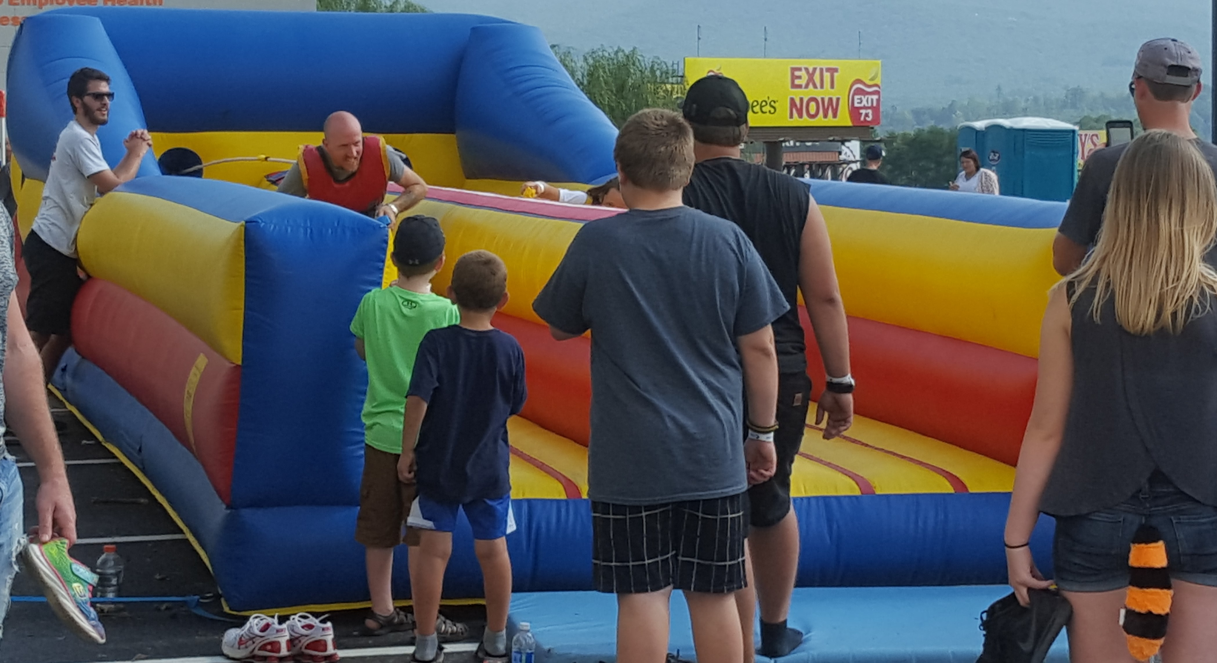 Two people race to see who can run out the farthest before being pulled back by the bungee cord. 35' l x 11' w x 8' h.