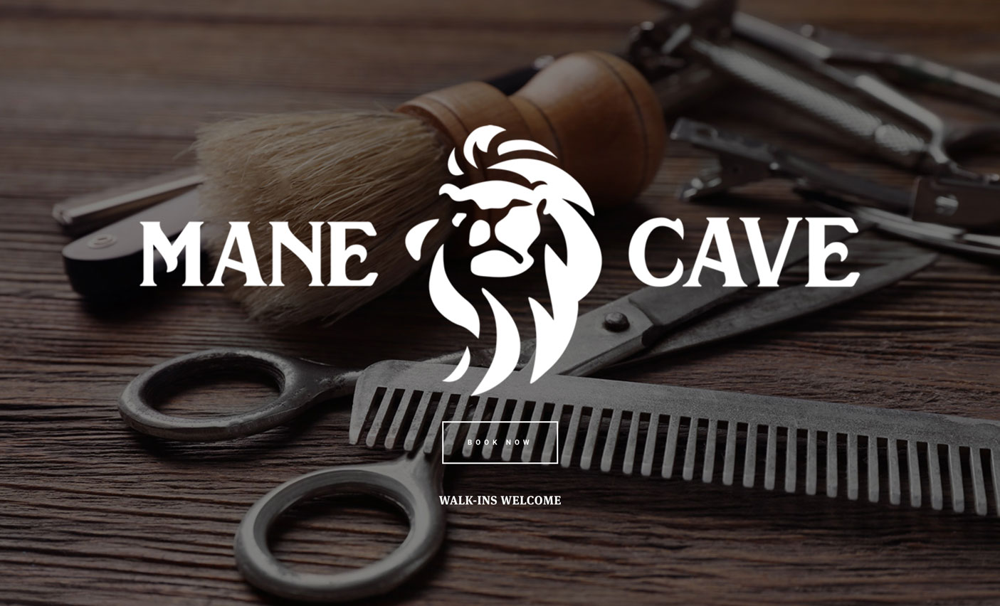 Screenshot of the landing page for Mane Cave Barbershop's new website.