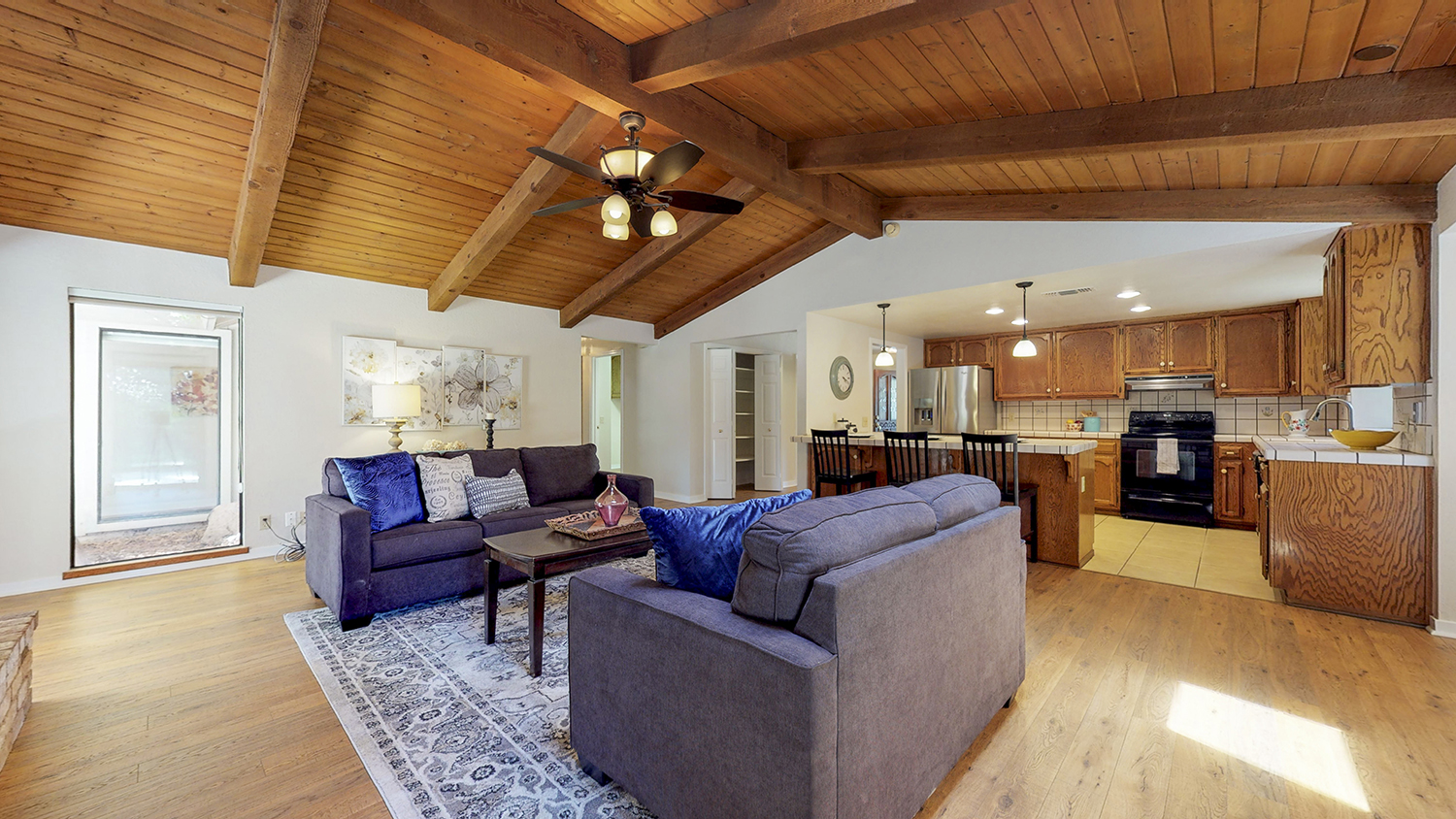 photography portfolio example - alternative angle of living room with wooden ceiling viewing into the kitchen