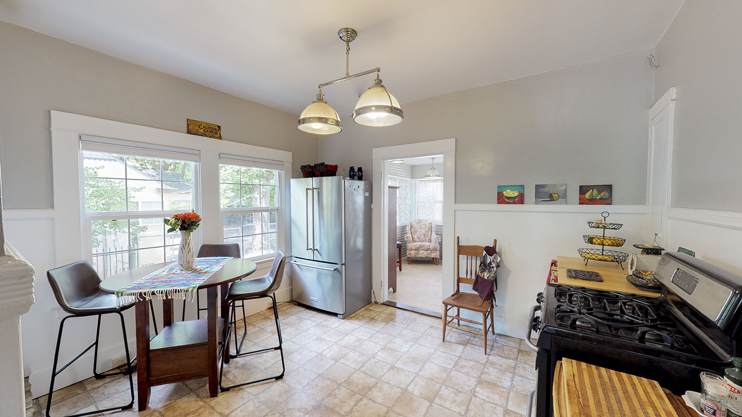 photography portfolio example - kitchen with high top round dining table and stove