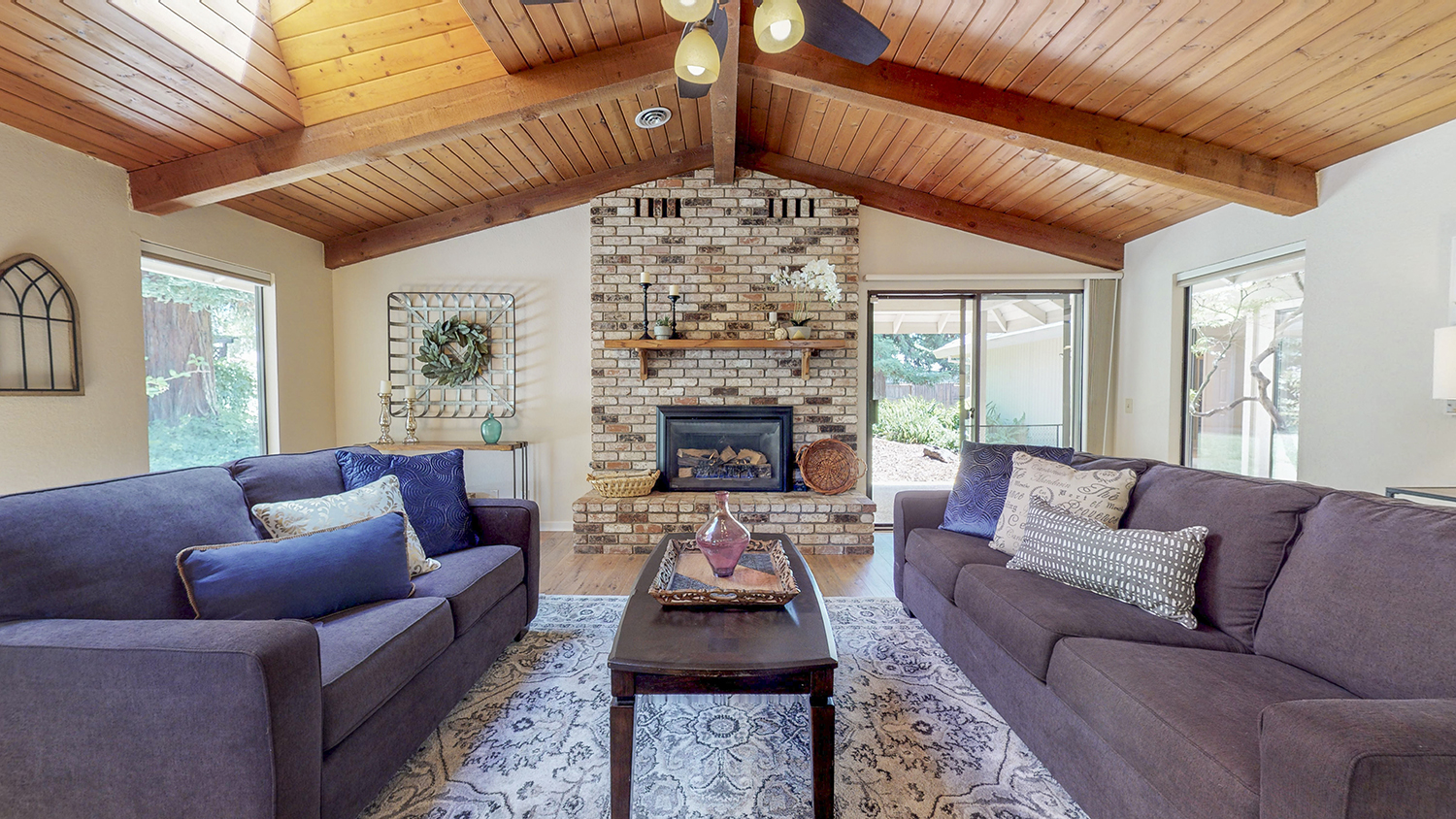 photography portfolio example - living room with brick fireplace and wooden ceiling