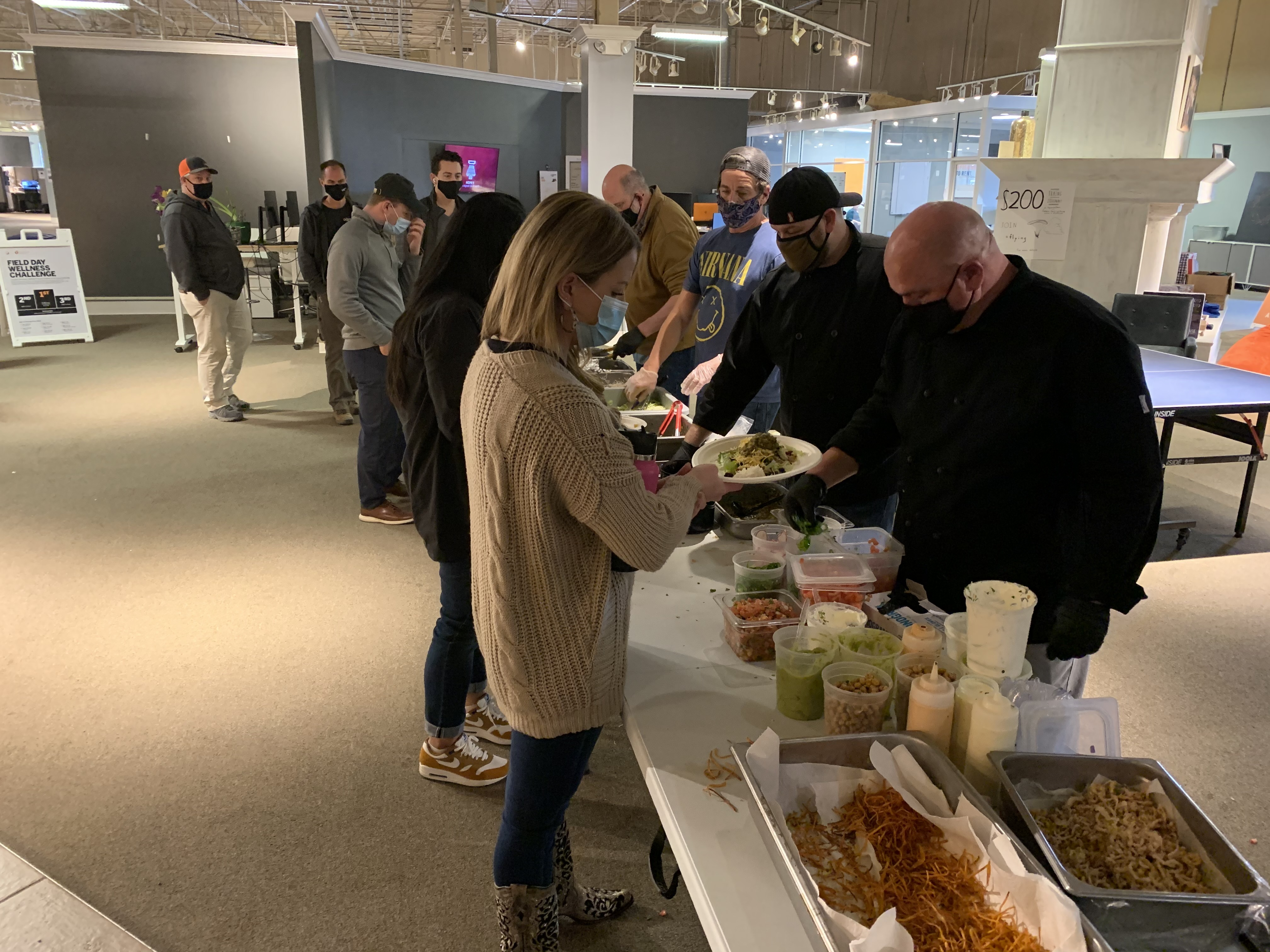 Employees enjoy a taco bar for lunch on Employee Appreciation Day
