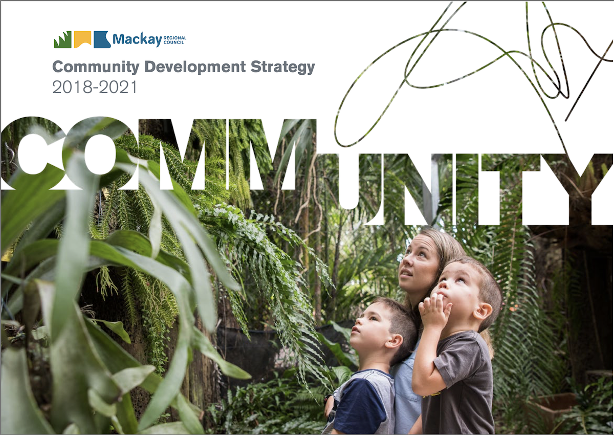 "Cover page of the community development strategy, includes a photo of two boys and a woman in the rainforest, the Mackay Council logo and text saying ""Community""."