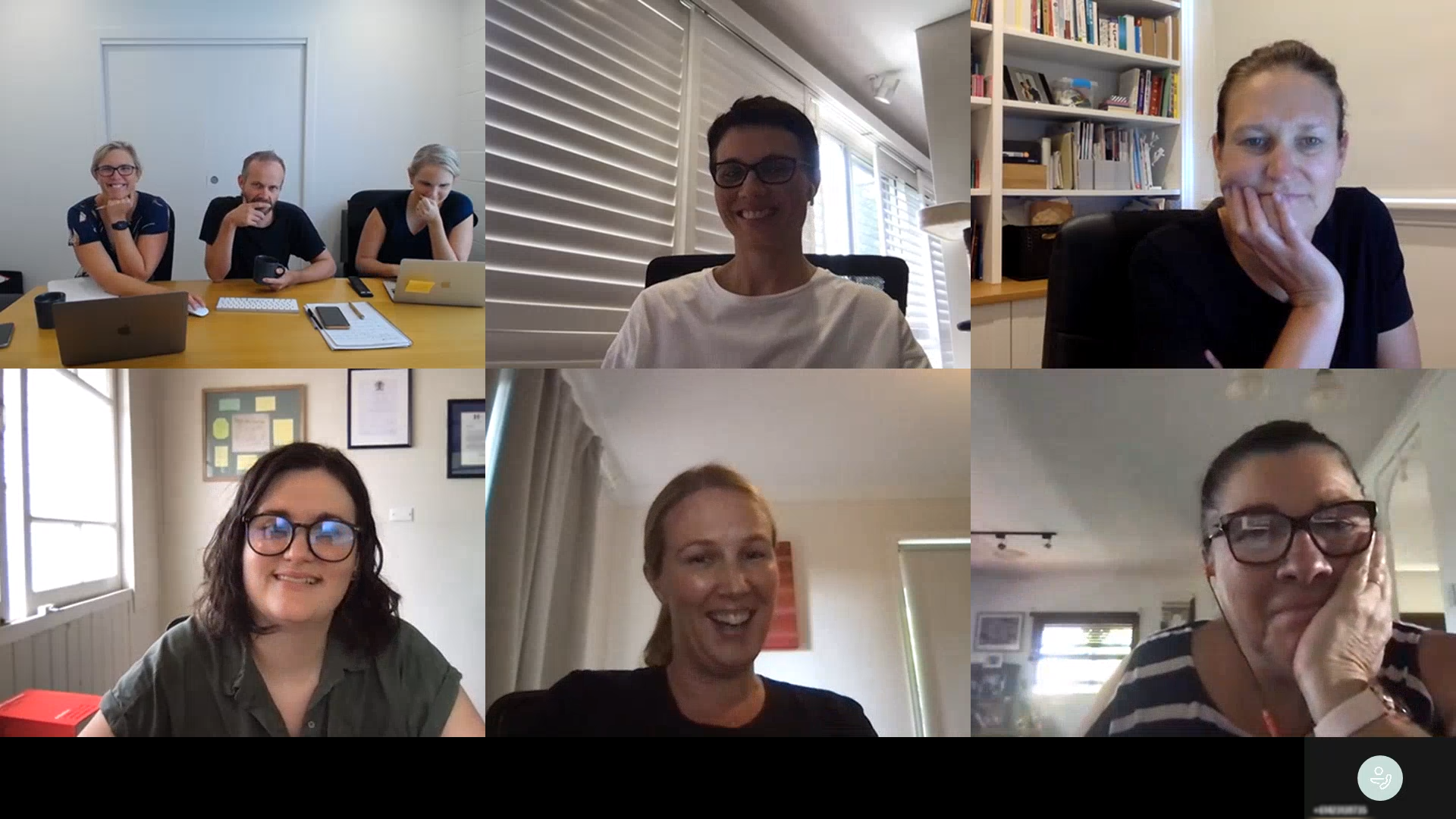 Screenshot of a Microsoft teams video call separated into six participants. In the top left there three people wearing black at a conference table, in the top middle there is a woman in glasses and a white shirt in front of window blinds, in the top right there is a woman in a black shirt with bookshelves behind her, in the bottom left is Alix with a window and framed pictures behind her, in the bottom middle is a blond woman in a black shirt speaking, and in the bottom right is a woman in a black and white striped shirt with glasses.