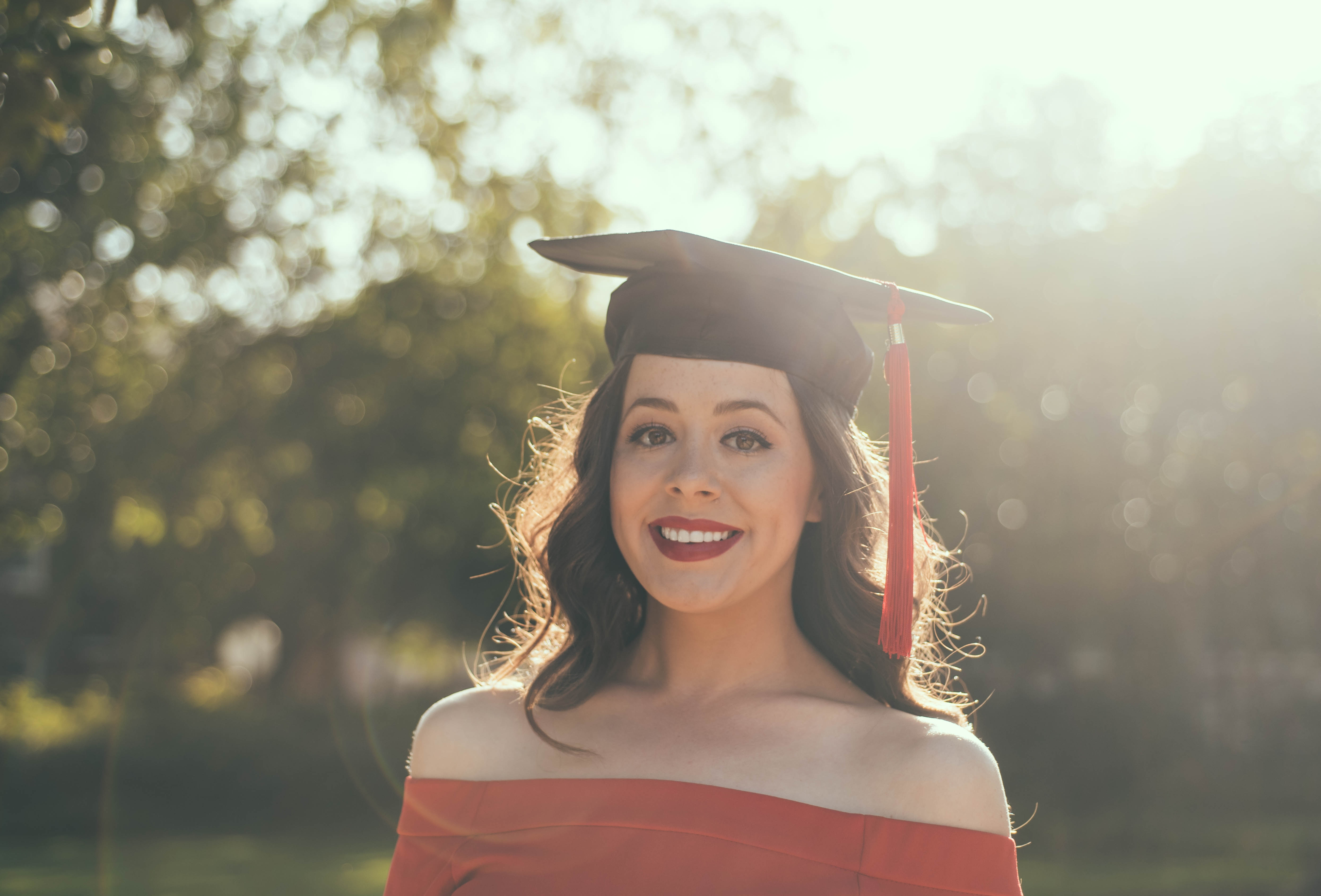 women with graduation hat
