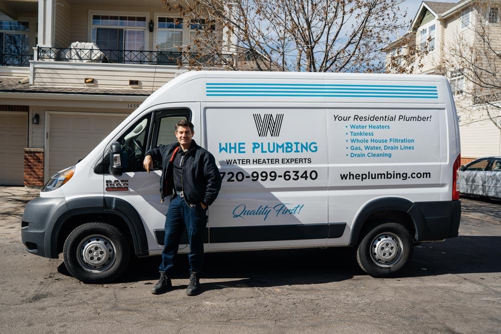 Alex in front of Water Heater Plumbing Experts Van