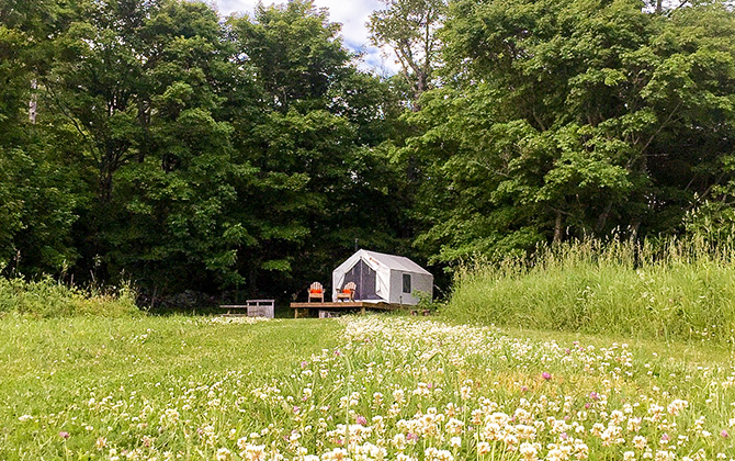 Private campground in rolling green hills with Tentrr signature camping setup.