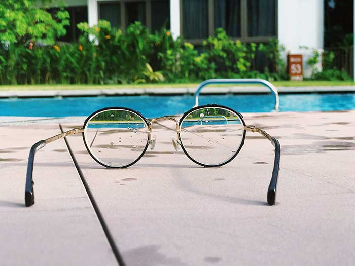 glasses by pool sunny outside australia