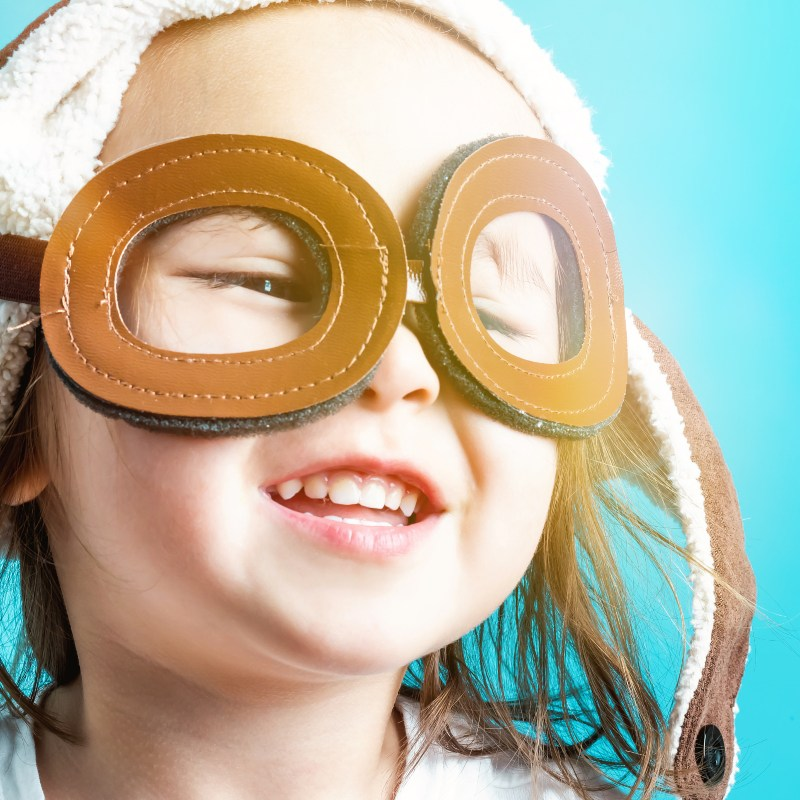 Child with aviator goggles